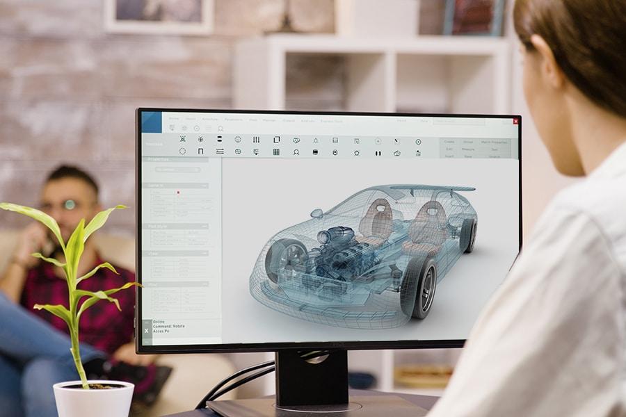 Bild Unterricht Siemens NX Frau vor Bildschirm mit Automodell